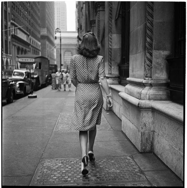 A woman confidently strides down a New York street