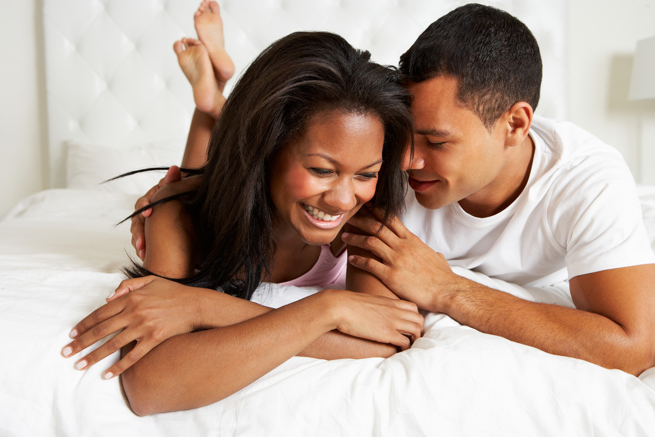 bigstock-Couple-Relaxing-In-Bed-Wearing-46447144.j