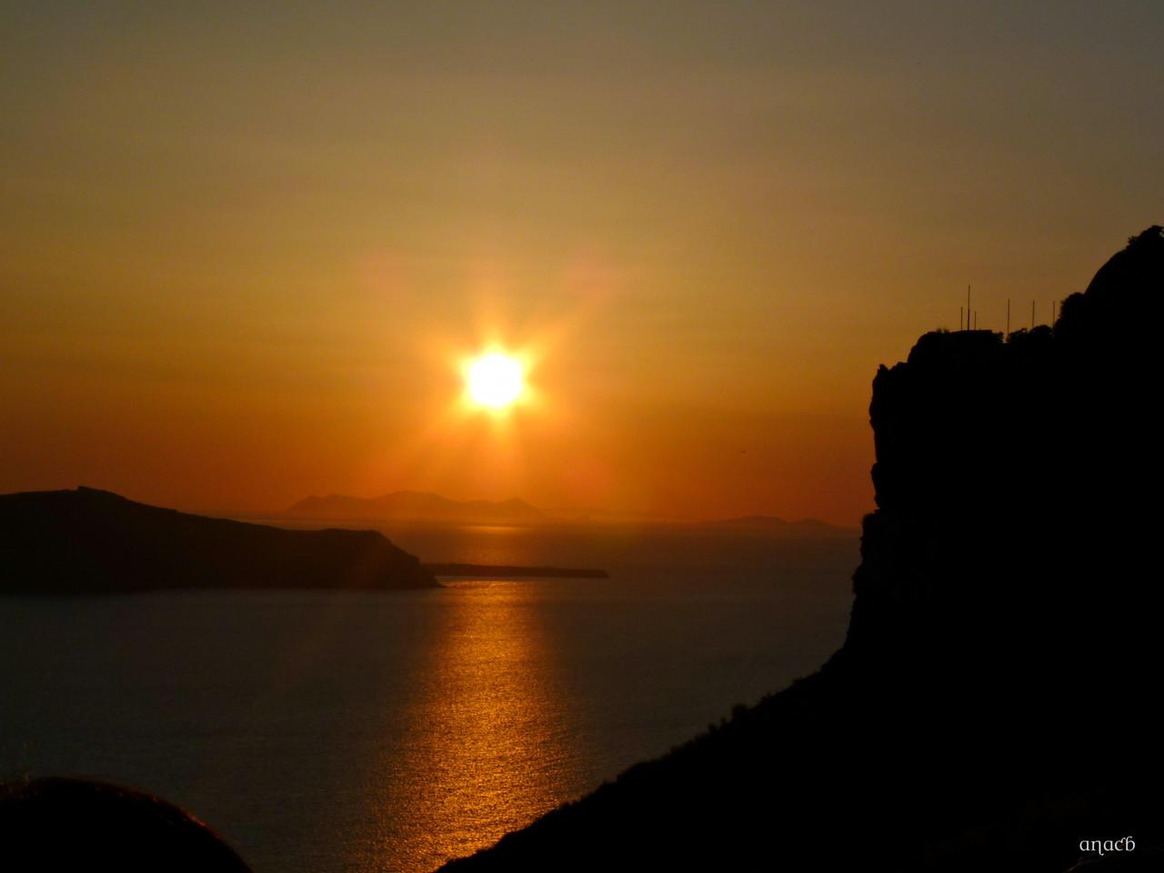 Santorini-o pôr-do-sol visto de Fira (1512) cópi