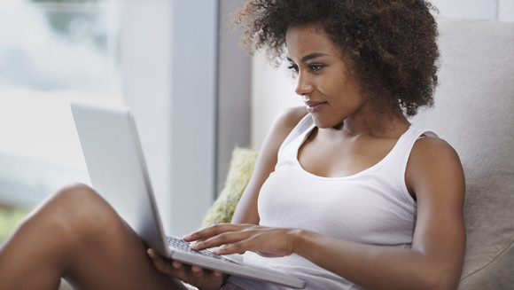 Woman-using-laptop-on-couch.jpg